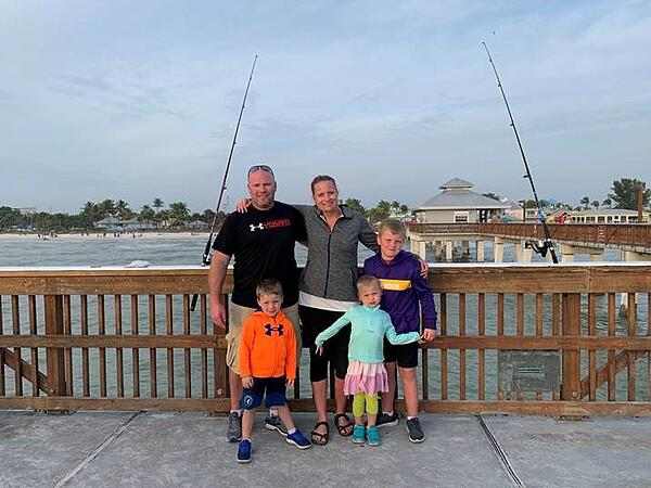 employee's family on incentive trip - Fishing on pier
